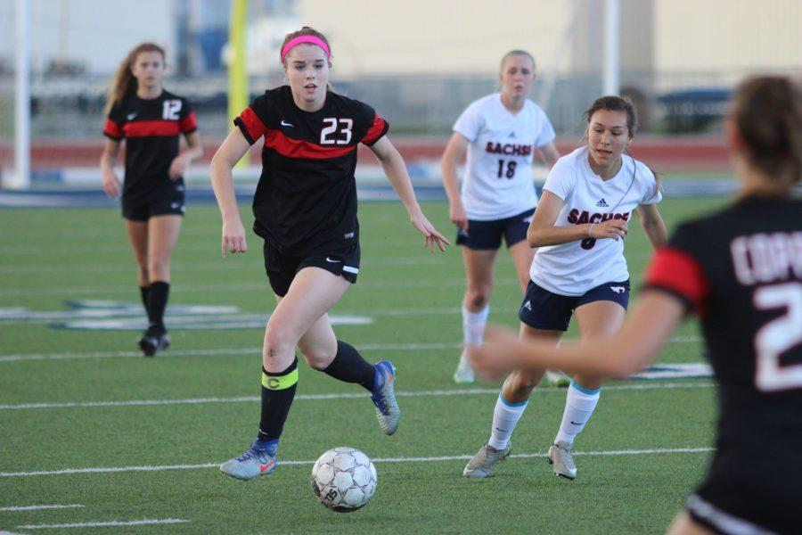 Coppell High School senior defender Sarah Houchin dribbles down the field as the first half of Tuesday night's match against Sachse comes to a close. The Sachse Lady Mustangs claimed a 1-0 victory over the Coppell Cowgirls, ending the Cowgirls' season in the Class 6A Region II quarterfinals.