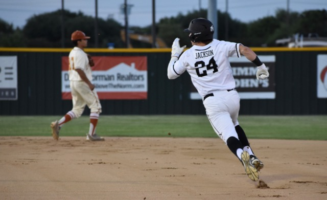 Coppell+High+School+sophomore+Blake+Jackson+runs+to+second+base+during+the+first+inning+of+Friday+night%E2%80%99s+game+at+the+Coppell+ISD+Baseball%2FSoftball+Complex.+The+Cowboys+defeated+W.T.+White+11-1.+