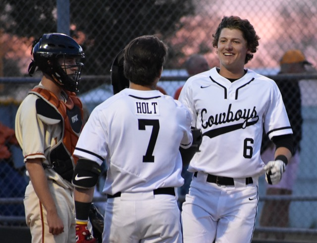 Coppell+High+School+senior+Jacob+Nesbit+celebrates+Austin+Gross%E2%80%99+two-run+home+run+during+the+first+inning+of+Friday+night%E2%80%99s+game.+The+Cowboys+defeated+W.T.+White+11-1+at+the+Coppell+ISD+Baseball%2FSoftball+Complex.+%0A