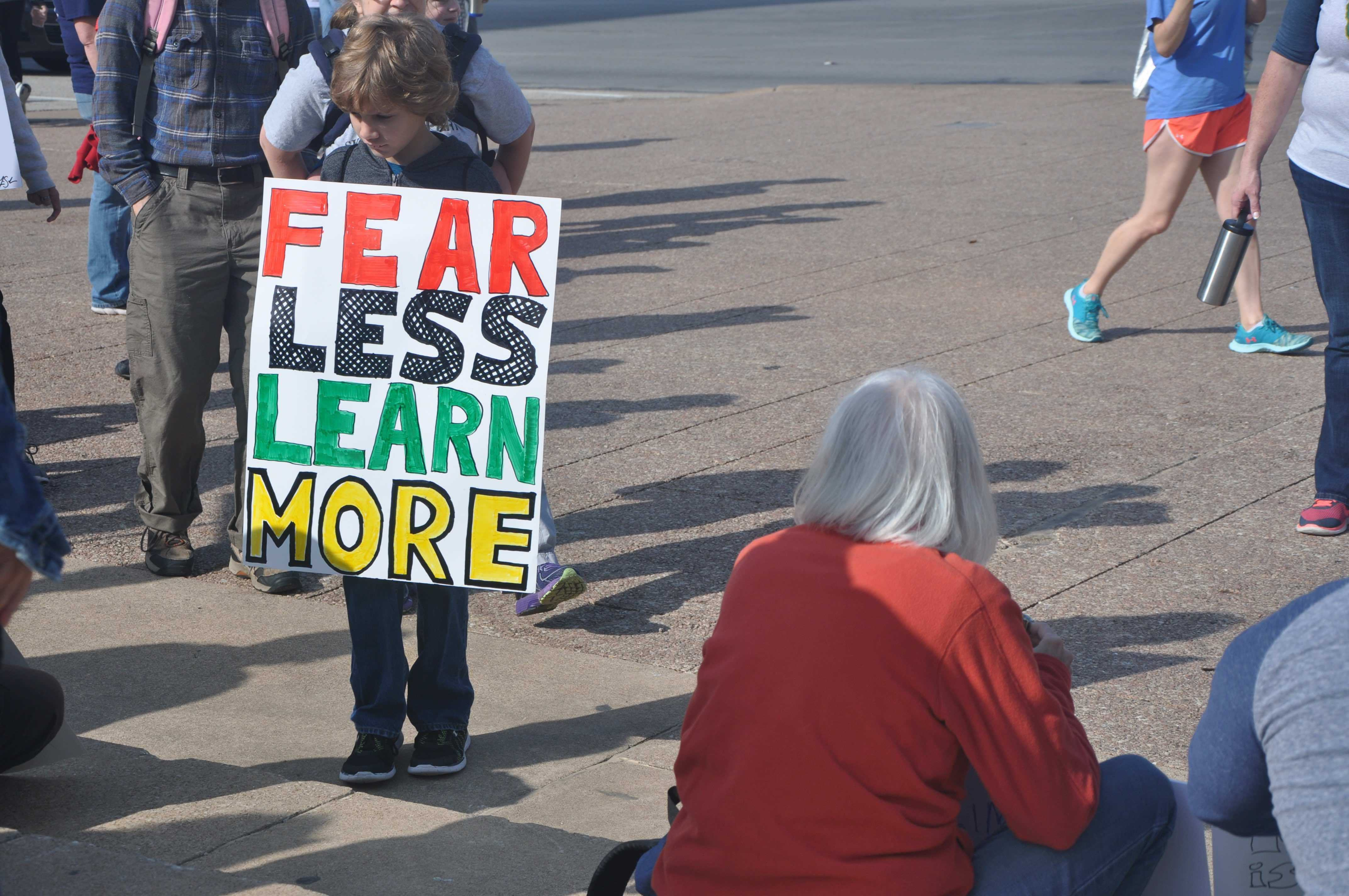 A+boy+holds+a+sign+up+before+the+March+for+Science+in+front+of+Dallas+City+Hall+on+Saturday.+The+march+began+at+Dallas+City+Hall+and+ended+at+Earth+Day+TX+at+Fair+Park.