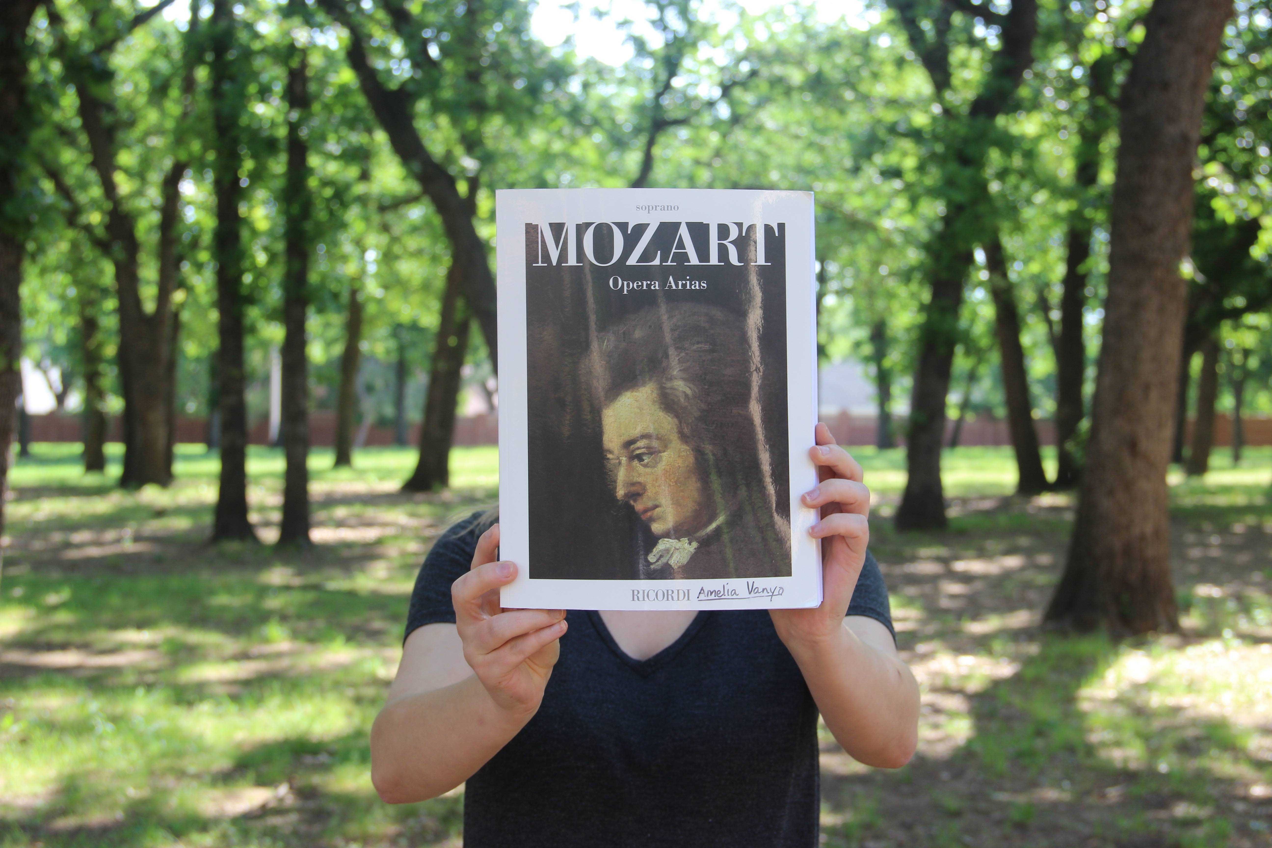 Coppell High School junior Amelia Vanyo holds up her Mozart Opera Arias book out front of CHS. Vanyo has been singing for eight years and wants to study vocal performance in college. Photo by Bren Flechtner.