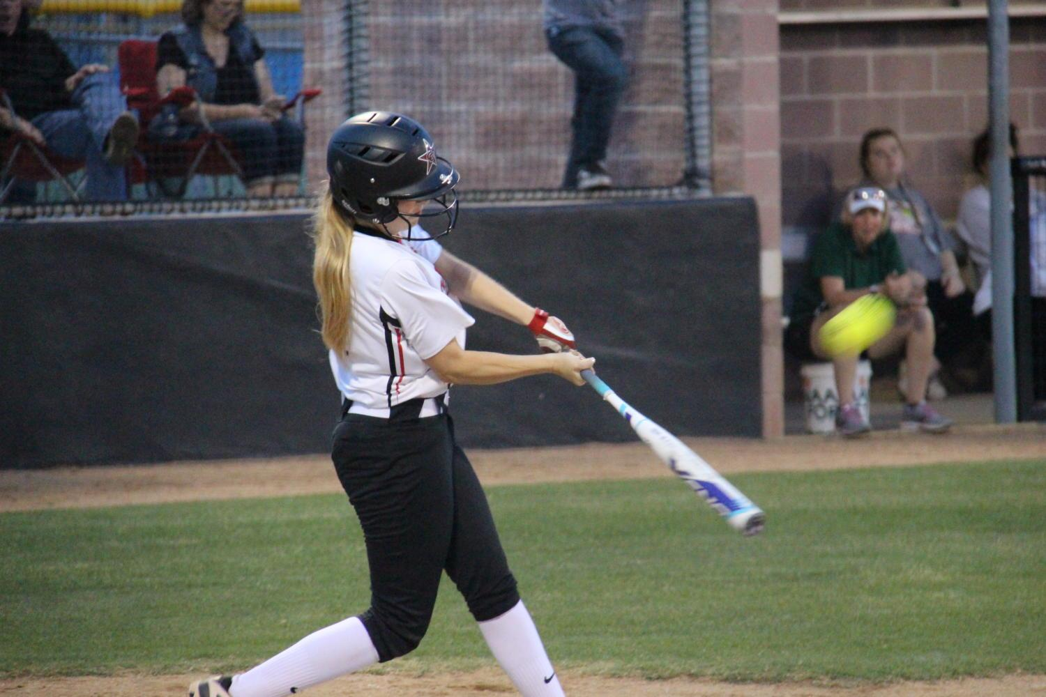 Coppell+senior+first+baseman+Alex+Denton+flies+out+to+deep+centerfield+in+the+second+inning+of+Coppell%E2%80%99s+18-1+win+over+Garland+Naaman+Forest+in+the+Class+6A+Region+II+bi-district+round+of+playoffs+at+the+Coppell+ISD+Softball%2FBaseball+Complex+on+Friday+night.+Denton+went+3-for-4+with+two+singles+and+two+RBIs.
