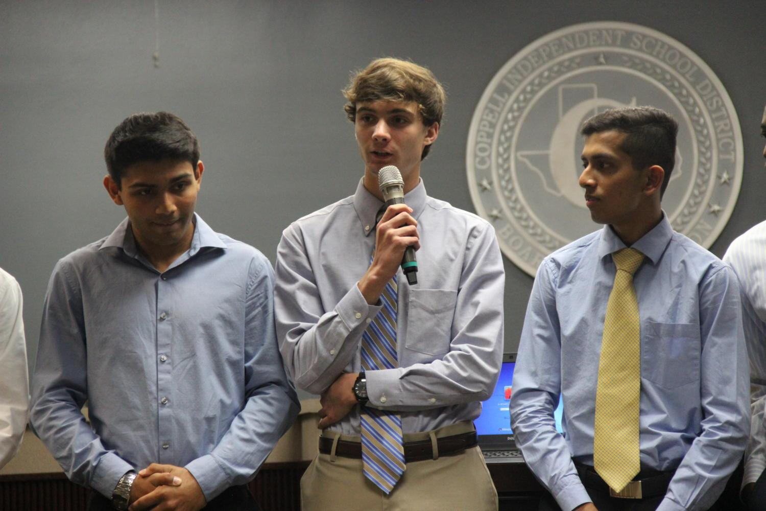 Coppell High School Track Coach Nicholas Benton's Academic All-State qualifiers were recognized at Monday night's Board of Trustees meeting. Boys track All-State qualifier Evan Harr introduces himself to the packed room in the Vonita White Administration Building.