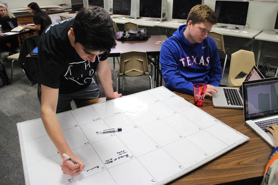Junior editors Joseph and Marcus Krum work on the sports game schedule in their newspaper in Feb. 2016. Marcus is the Executive Sports Editor for the 2016-2017 school year, while Joseph is the Executive Enterprise Editor.