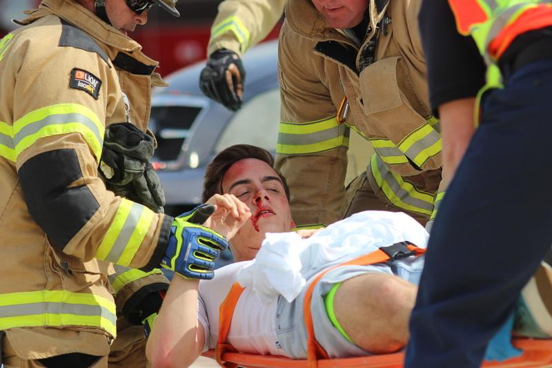 Coppell High School senior Jack Dalrymple lays on gurney as a part of the Shattered Dreams program that took place this morning in the CHS parking lot. An intense car accident scene was portrayed to Coppell juniors and seniors in order to showcase the seriousness of drinking and driving.