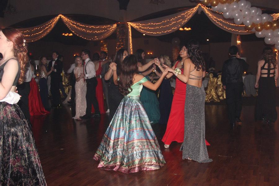 A group of students dance together at the 2017 CHS Prom on Saturday at Southfork Ranch. The floor was surrounded by balloons overhead providing a fun setting for dancers.