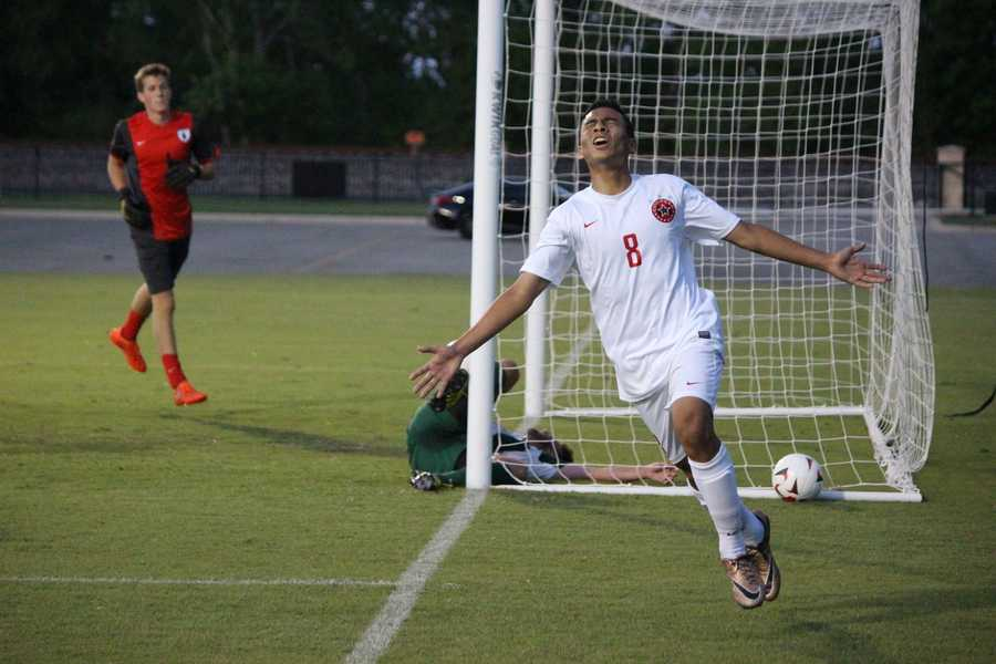 Coppell High School senior captain and midfielder Bishesh Manandhar celebrates after scoring the final goal of Friday's match against The Woodlands at the University of Mary Hardin-Baylor. The Cowboys lead by three goals, after the first half and despite three goals from The Woodlands in the second half, held onto their lead to win, 6-3, in the area round of playoffs.