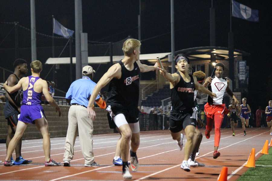 Coppell High School senior Matt Dorrity passes the baton to senior Zach Dicken in the Men's 4x400 Relay Finals of the UIL District 9-6A Track & Field Championships hosted by Jesuit Dallas at Postell Stadium on Tuesday night. The Coppell team consisted of sophomore Christian Leffingwell, junior Gabriel Lemons, senior Matthew Dorrity and Dicken. The team placed second in the event, after Dallas Skyline, with a time of 3:24.37.