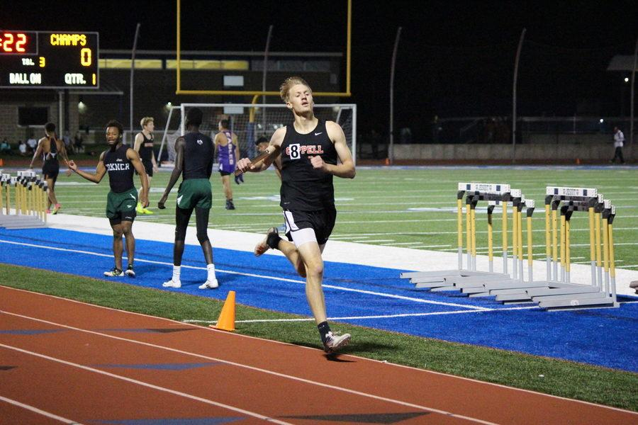 Coppell High School senior Zach Dicken sprints to the finish line in the Men's 4x400 Relay Finals of the UIL District 9-6A Track & Field Championships hosted by Jesuit Dallas at Postell Stadium on Tuesday night. The Coppell team consisted of sophomore Christian Leffingwell, junior Gabriel Lemons, senior Matthew Dorrity and Dicken. The team placed second in the event, after Dallas Skyline, with a time of 3:24.37