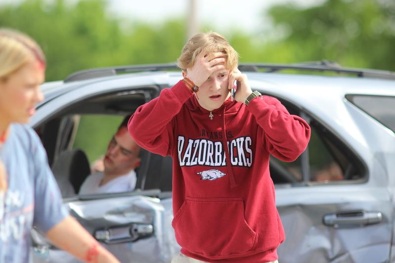 This morning in the Coppell High School parking lot, New Tech High@Coppell senior Kyle Cloutier calls the police after the unfolding of the mock accident scene at CHS. Shattered Dreams is put on every other year at CHS and is meant to show students the seriousness of drinking and driving.