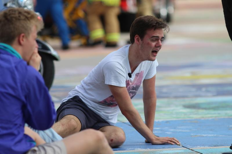 Coppell High School senior Ty Dalrymple screams as he watches his brother, Jack Dalrymple, die at the scene of the mock accident as a part of Shattered Dreams this morning in the CHS parking lot. The point of Shattered Dreams is to show juniors and seniors the possible effects of drinking and driving.