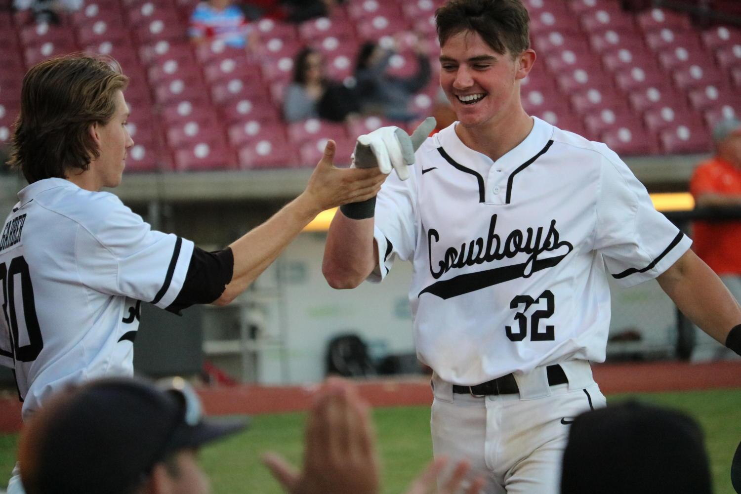 The Coppell High School varsity baseball team congratulates CHS senior Cody Masters after he scores the first run of Thursday night's game against Naaman Forest. The Coppell Cowboys defeated the Naaman Forest Rangers 13-0 at the AirHogs Stadium.