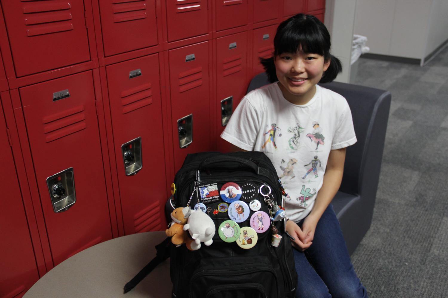 Coppell+High+School+sophomore+Karina+Teruya+displays+her+buttons%2C+which+feature+different+philosophers+and+puns%2C+on+her+backpack.+She+raised+approximately+%24200+in+funds+for+Latin+competitions+and+spread+awareness+about+Latin+III+and+IV+classes+being+cut+next+year.+