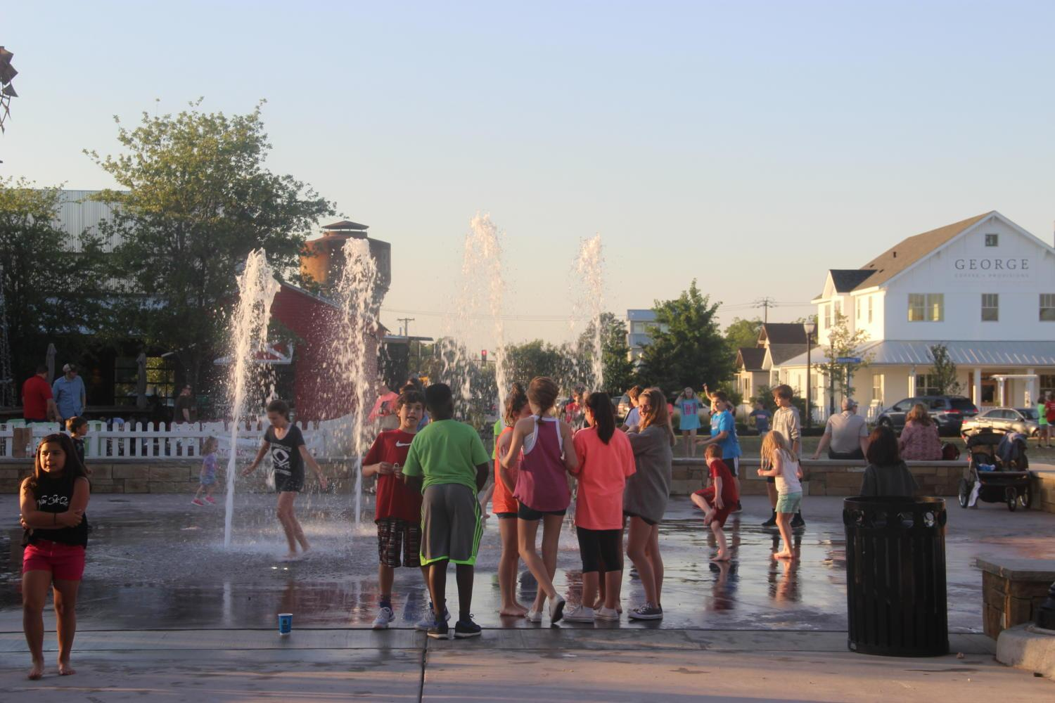 Kids+play+around+in+the+Main+Street+Interactive+Fountain+at+the+Square+of+Old+Town+Coppell+for+the+Concert+on+the+Lawn+last+night.+Many+kids+were+free+to+splash+in+the+water+during+the+event.