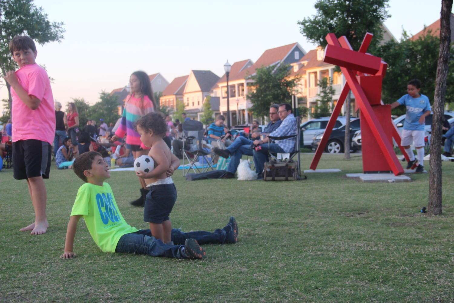 Two+kids+play+soccer+with+each+other+during+the+Coppell+Concert+on+the+Lawn+event+at+the+Square+of+Old+Town+Coppell+last+night.+Children+from+all+over+Coppell+played+games+and+danced+to+the+music.