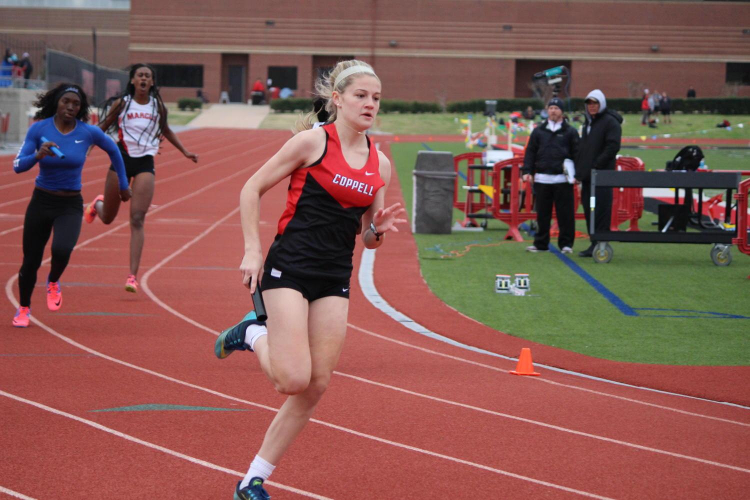 Coppell High School freshman multisport athlete Lauren Kellett runs a relay race at Buddy Echols Field during the Coppell Relays on March 4. Kellet won The Sidekick's Freshman Athlete of the Year honors. Photo by Kelly Monaghan.