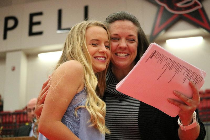 Coppell+High+School+counselor+Trisha+Fiene-Spain+hugs+senior+Hannah+Pridgen+after+giving+her+an+award+in+the+CHS+Arena+on+Wednesday+morning+at+Senior+Awards.+Senior%E2%80%99s+were+treated+to+breakfast+before+school+and+then+given+awards+at+the+senior+awards+ceremony+where+sophomores+and+juniors+onlooker.