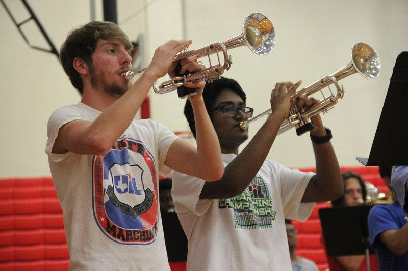 Coppell High School junior Grant Knippa and sophomore Koushik Thudi play the trumpet at Hype Day for the CHS Band in the big gym on Saturday. For the first time, the Coppell Band hosted a 'hype day,' which is an experience camp for incoming freshman and a refresher for band vets.