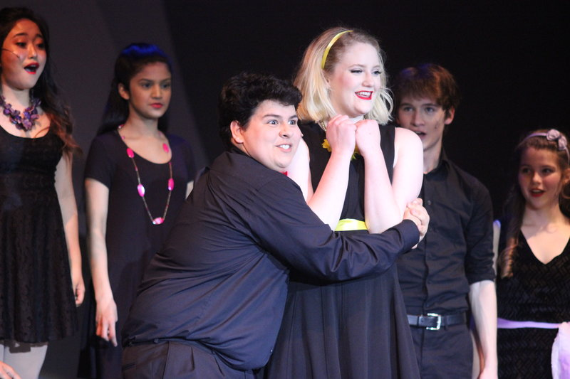 Coppell+High+School+junior+Mark+Beshai+wraps+his+arms+around+sophomore+Kyra+Holmstrup+during+the+song+%E2%80%9CShipoopi%E2%80%9D++on+Friday+night+in+the+CHS+Auditorium.+The+CHS+theatre+department+performed+their+latest+work+%22Fame%2C%22+which+is+a+variety+of+songs+from+different+musicals+compiled+into+one+night.+Photo+by+Hannah+Tucker.