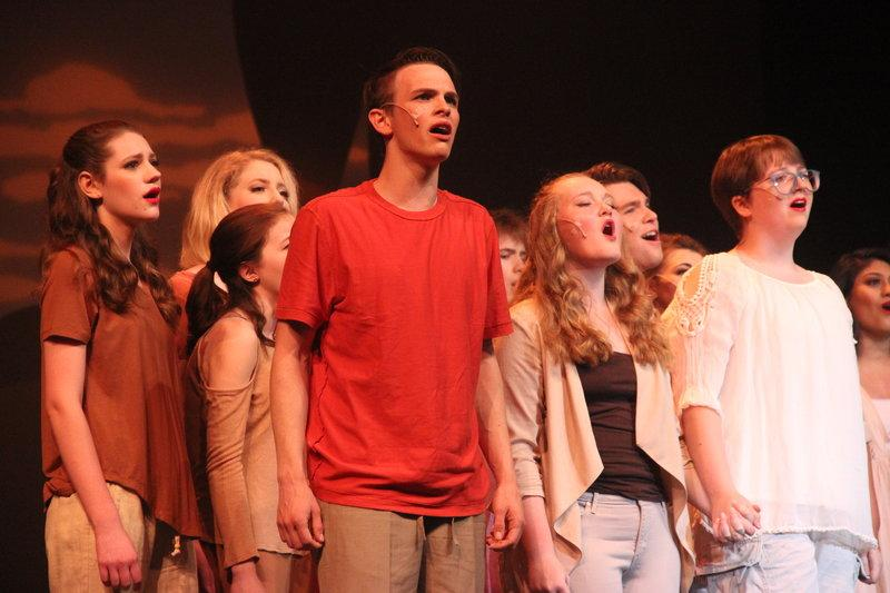 Kids+from+the+CHS+Theater+Department+rise+to+their+feet+to+sing+%E2%80%9CThe+Gods+Love+Nubia%E2%80%9D+from+the+play+%E2%80%9CAdia%E2%80%9D+on+Friday+night+in+the+CHS+Auditorium.+The+CHS+theatre+department+performed+their+latest+work+%22Fame%2C%22+which+is+a+variety+of+songs+from+different+musicals+compiled+into+one+night.+Photo+by+Hannah+Tucker.
