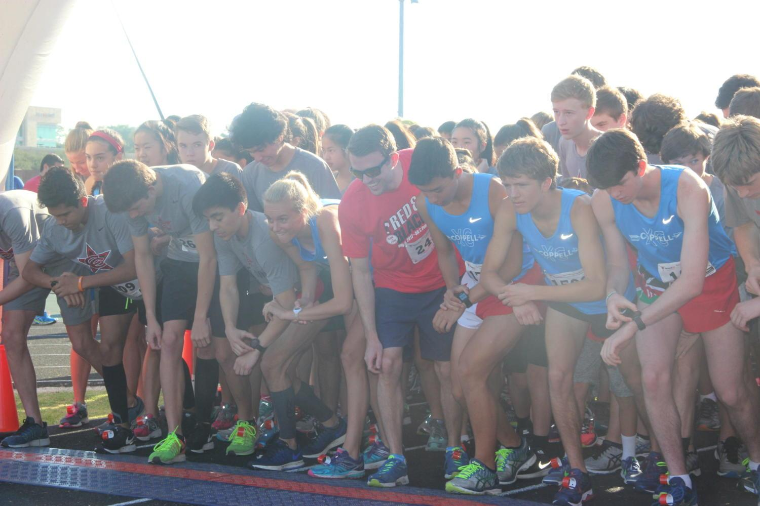 Runners take their mark at the beginning of the 5K race. The Red and Black Run to Fund was hosted by the Coppell Education Foundation and took place on Saturday morning at Coppell Middle School North.