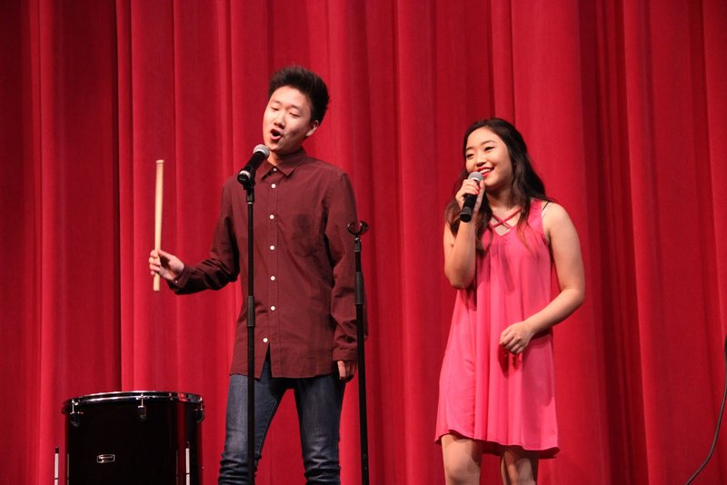 Coppell+High+School+seniors+Daniel+Kim+and+Tara+Park+sing+a+duet+to+Us+the+Duo%E2%80%99s+%E2%80%9CNo+Matter+Where+You+Are.%E2%80%9D+Members+of+Vivac%C3%A9%21+performed+a+Spring+Show+on+Friday+night+and+Saturday+afternoon+in+the+CHS+auditorium.+