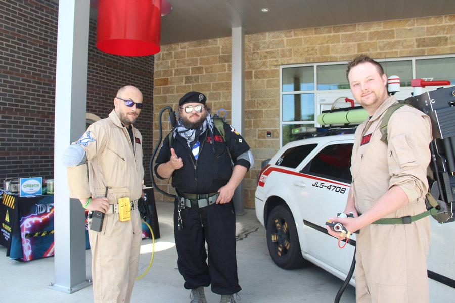 The Dallas-Fort Worth Ghostbusters group spend time outside the Cozby Library and Community commons at Cozby Con on May 13 in the afternoon. The group is a not-for-profit that visits local conventions.