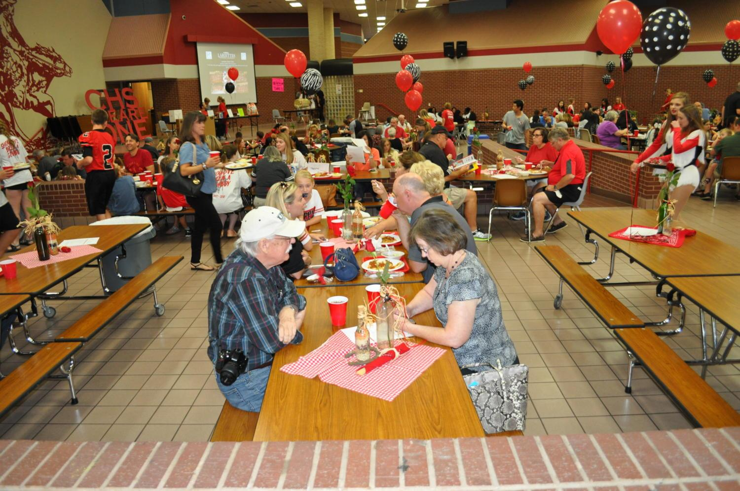 Coppell families gather together to enjoy a long-time tradition; the Spaghetti Dinner hosted by the Coppell High School Lariettes. The event allows families to enjoy food, fellowship and fun while supporting their school and community. Photo by Nolan Sanders