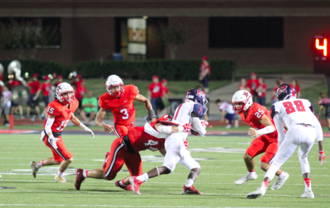 4. Coppell High School senior Pierce McFarlane tackles McKinney Boyd as they run the ball for a touchdown. Last nights game at Buddy Echols Field was a close game, but the cowboys went home with a win, 34-24. Photo by Bren Flechtner.