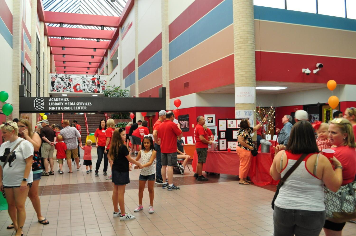 Attendees of the Spaghetti Dinner view the silent auction tables on Friday night in the CHS commons. The event offered Coppell students and citizens a chance to support the Lariettes by way of raffle prizes, baked goods, and silent auctions, and the delicious spaghetti dinner. Photo by Nolan Sanders