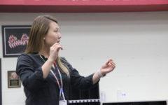 Coppell High School head choir director Bona Coogle conducts a song during eighth period choir class. This year, Coogle is serving as the new CHS head choir director.