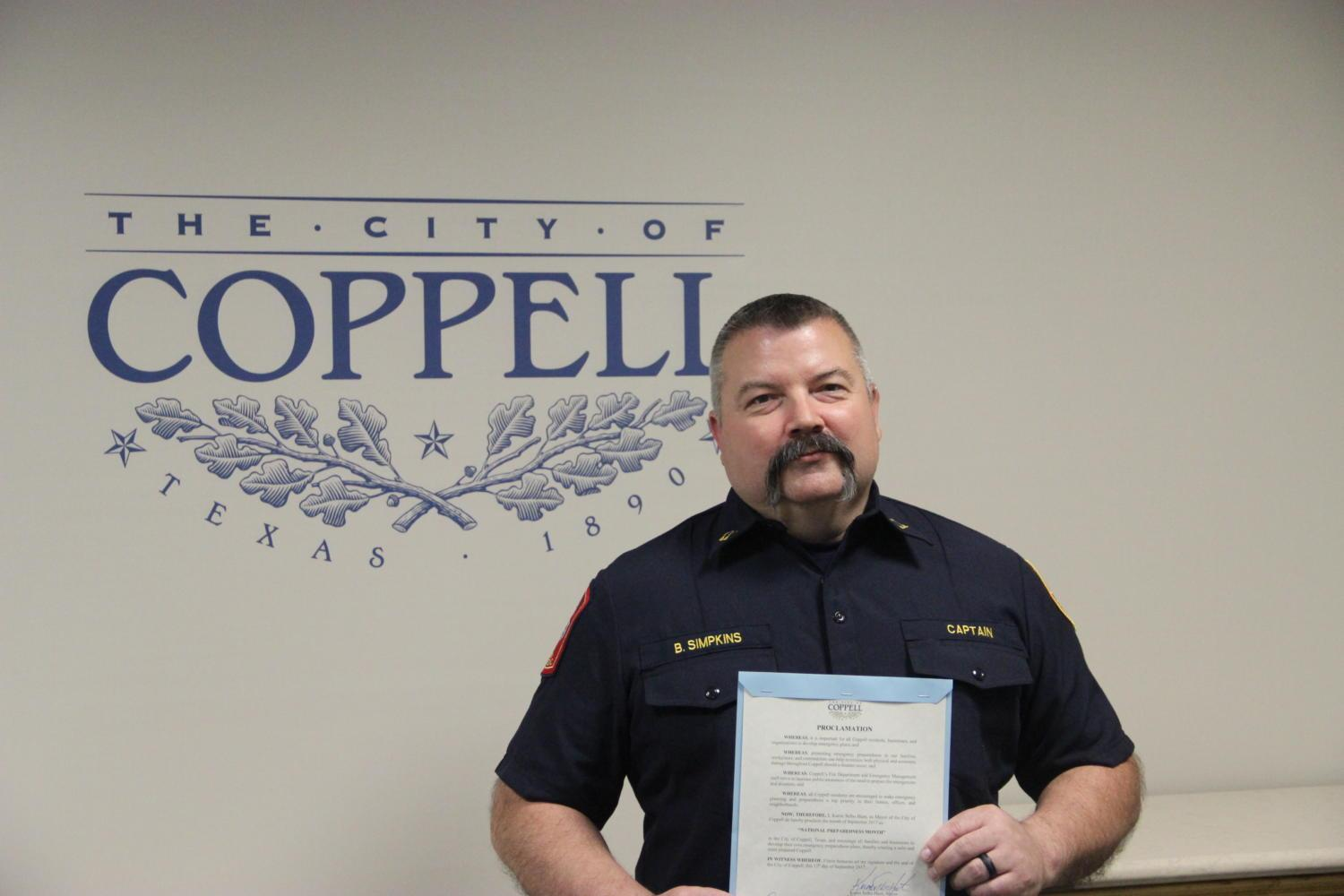 """At Tuesday's City Council meeting, Coppell Fire captain Brad Simpkins holds the signed proclamation signed by Mayor Karen Hunt naming September 2017 as """"National Preparedness Month"""" in Coppell. """"The more prepared that individual families and businesses are, the better. We're pushing out public education information, throughout this month we will have distributions set up at the library, at the Core, Farmers Market, and we'll also be visiting businesses throughout the city,"""" Simpkins said."""