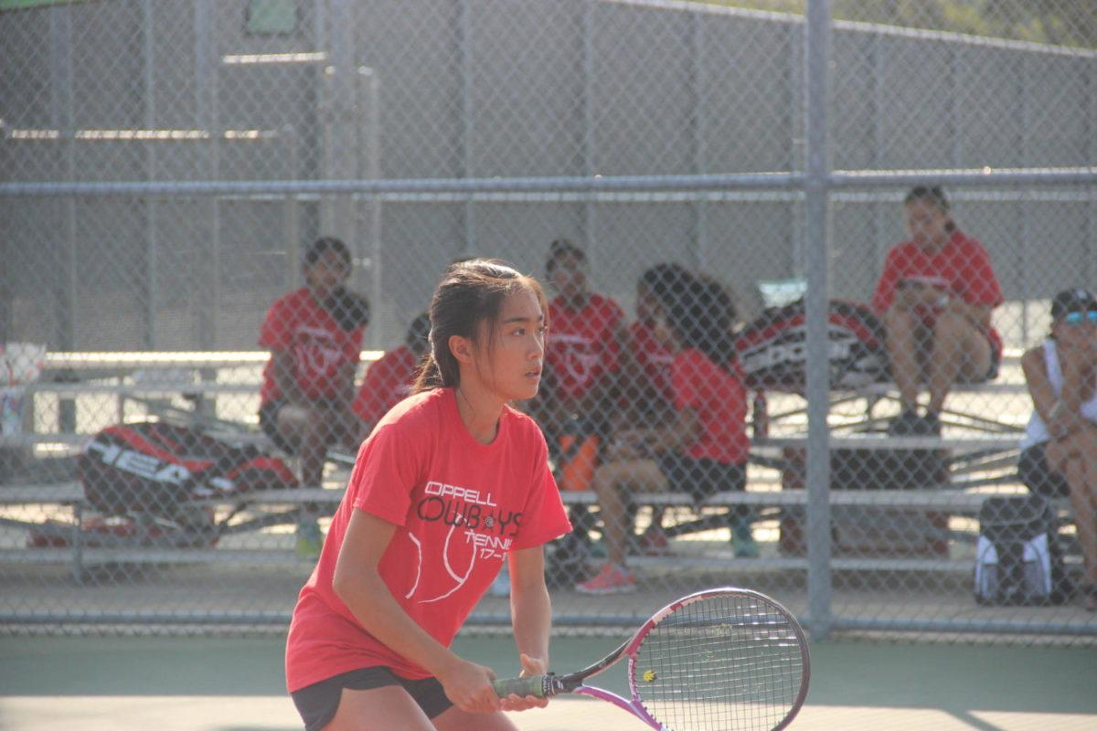 Coppell+High+School+junior+Suzuka+Nishino+watches+for+her+opponent%27s+next+move.++The+Coppell+High+tennis+team+warms+up+on+September+15th+after+school+before+their+match+against+Liberty+Christian.%0A