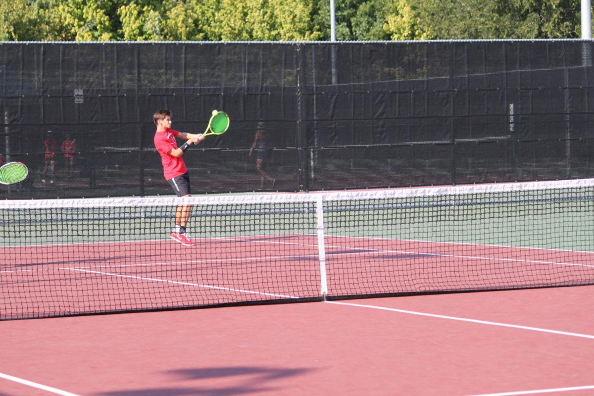 Coppell High School senior Victor Kalev strikes the ball back during a doubles match against Liberty Christian. Kalev played doubles with senior Justin Chen and won the match 7-5, 6-3.