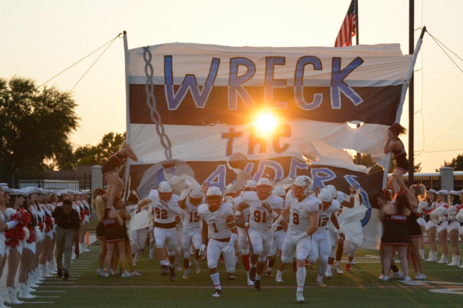 The+Coppell+Cowboys+football+team+takes+the+field+before+its+game+against+the+L.D.+Bell+Blue++Raiders+on+Sept.+1+at+HEB+Pennington+Field.+The+Cowboys+defeated+the+Blue+Raiders%2C+58-23.