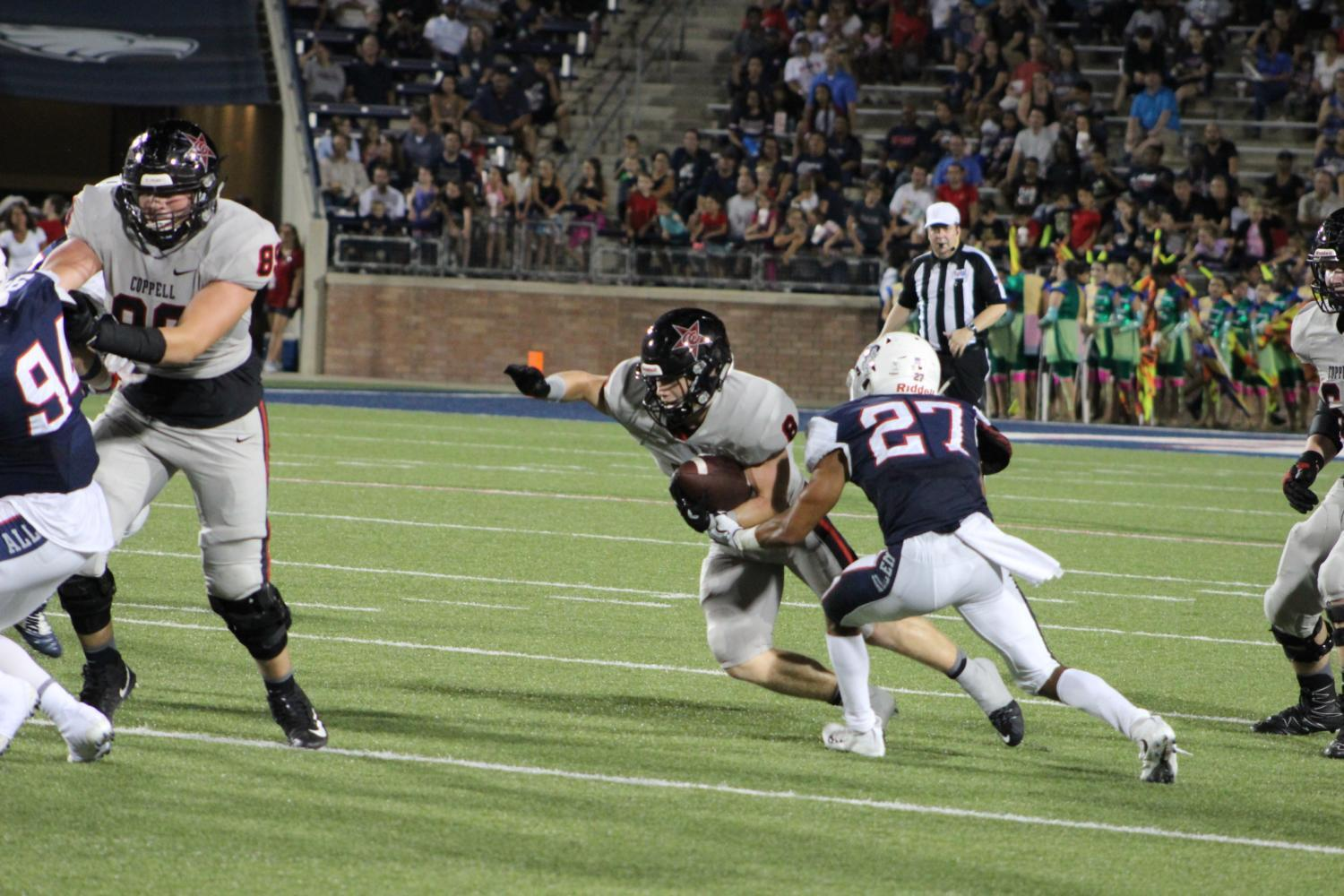 Coppell High School junior wide receiver Blake Jackson looks to run the ball after a pass from senior quarterback Brady McBride during the game against Allen Eagles at Allen Stadium. The Coppell Cowboys fell short to the  Allen Eagles 35-23.