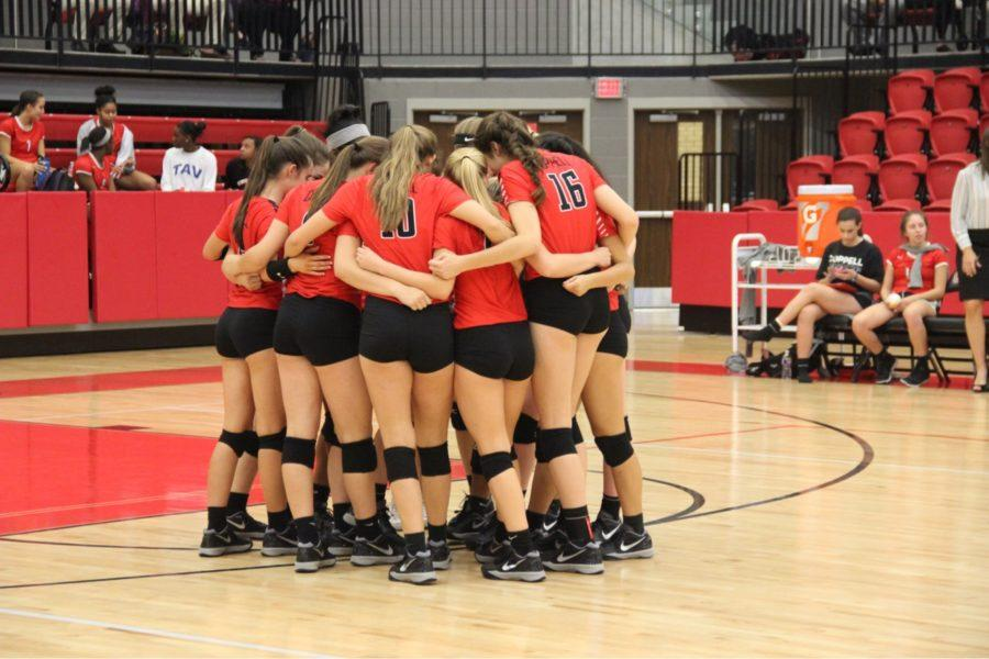 The+Coppell+High+School+varsity+volleyball+team+huddled+together+to+pray+before+their+game+against+the+Berkner+Lady+Rams.+The+Cowgirls+took+the+victory+and+won+all+three+sets+last+Tuesday+in+the+CHS+Arena.