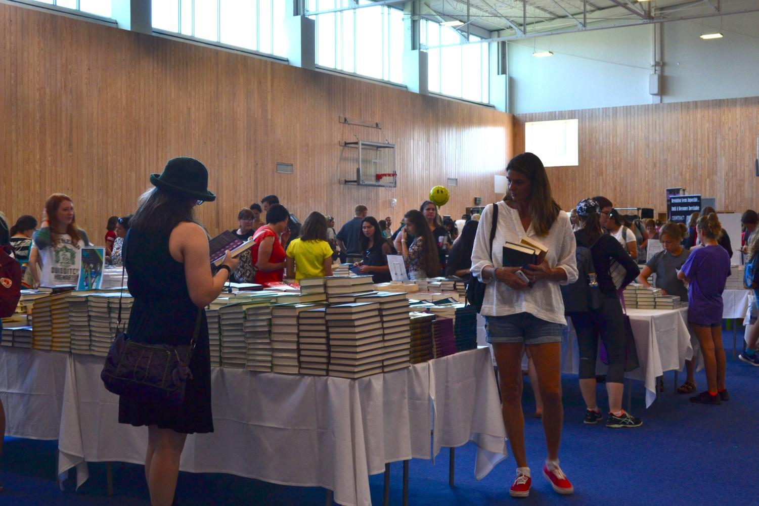 Texas Teen Book Festival attendees browse for books before the festival starts on Oct. 7 at St. Edward's University. Books were sold throughout the day by BookPeople so festival attendees could have them signed and personalized by their favorite authors.