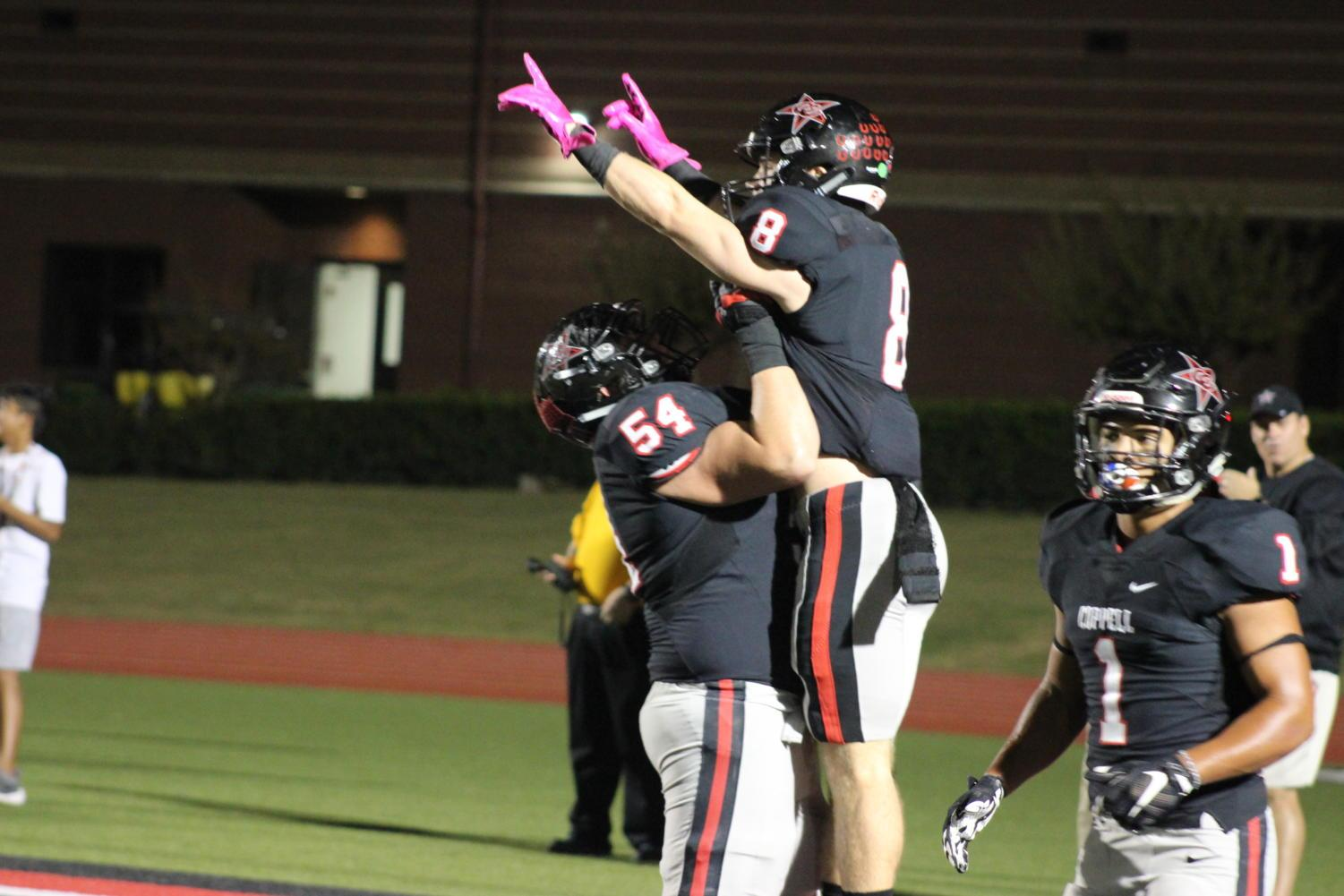 Coppell wide receiver Blake Jackson celebrates with lineman Mike Ruth after Jackson scores a touchdown on Friday night at Buddy Echols Field.  The Cowboys defeated the W.T. White Longhorns, 55-14, in District 9-6A play.