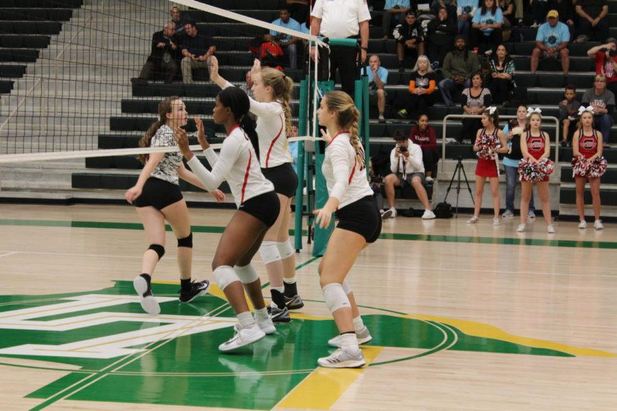 Coppell High School junior Amarachi Osuji (left), sophomore Peyton Minyard middle) and sophomore Kinsey Bailey (right) play defense against Lebanon Trail High School Monday night at Frisco Lebanon Trail's gymnasium. The Cowgirls defeated the Lady Rangers in three sets 25-8, 25-15, 25-20 to advance to the area round of the 6A state playoffs.