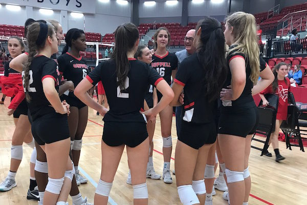 Coppell Cowgirls get in a huddle after Friday night's game in the arena. The Cowgirls defeated the Longhorns in three sets, 25-2, 25-4, and 25-3.