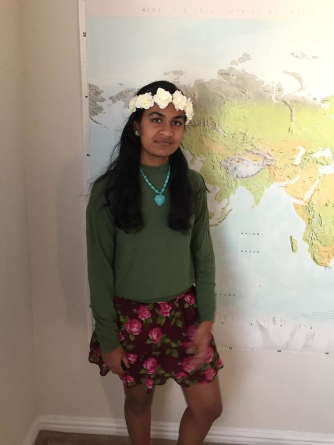 Coppell High School sophomore Anika Arutla dresses up as Te Fiti from the Disney movie Moana. To be Te Fiti, you can use a floral skirt, a green sweater, a flower crown, and floral jewelry.