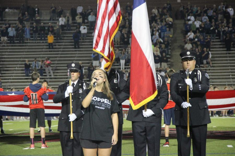Coppell+High+School+senior+Katie+Love+sings+the+National+Anthem+on+Sept.+29+at+Buddy+Echols+Field+in+honor+of+the+courageous+men+and+women+who+serve+the+United+States.+The+Coppell+Cowboys+defeated+the+Jesuit+Rangers%2C+63-41%2C+during+the+second+home+game+of+the+season.