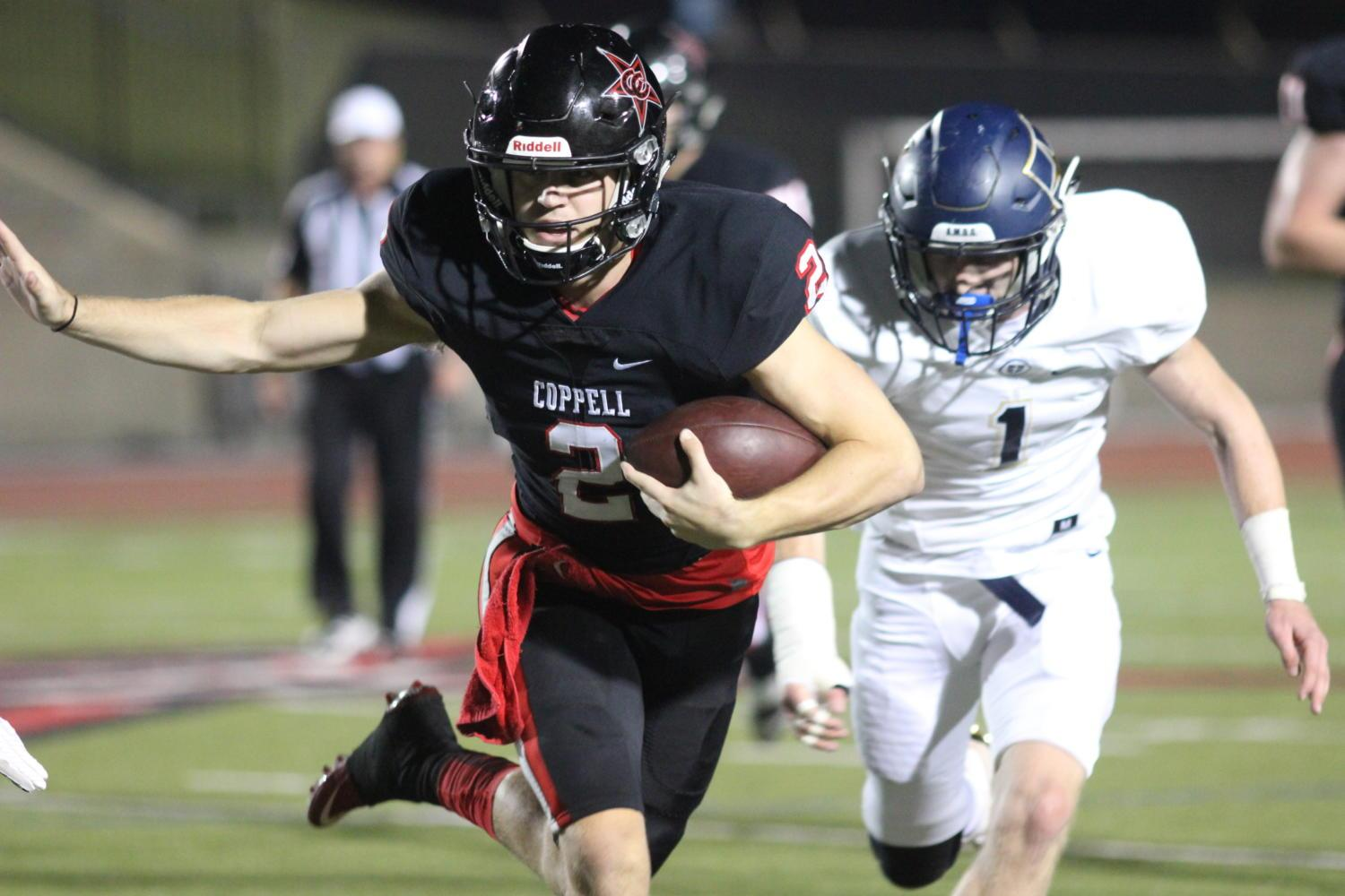 Coppell Cowboys senior quarterback Brady Mcbride runs ball-in-hand during the second quarter on Sept. 29 at Buddy Echols Field. The Coppell Cowboys win against the Jesuit Rangers, 63-41, during the second home game of the season.