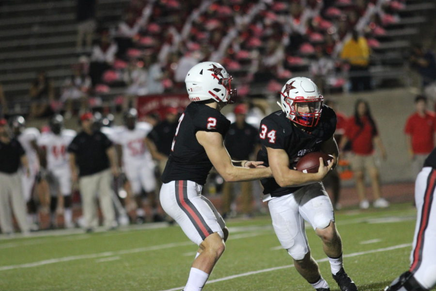 Coppell+Cowboys+senior+quarterback+Brady+McBride+passes+the+ball+to+junior+running+back+Ryan+Hirt+during+the+fourth+quarter+of+the+Homecoming+game+on+Oct.+13+at+Buddy+Echols+Field.+The+Coppell+Cowboys+defeated+the+Lake+Highlands+Wildcats+with+a+final+score+of+49-34.+