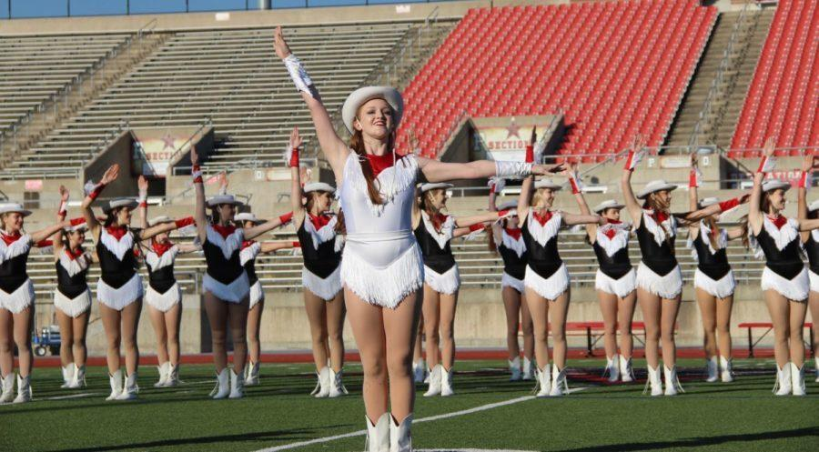 """Coppell High School Lariette senior Sarah Wales dances during the homecoming pep rally today.  The Lariettes performed their traditional homecoming dance """"Wild Wild West""""."""