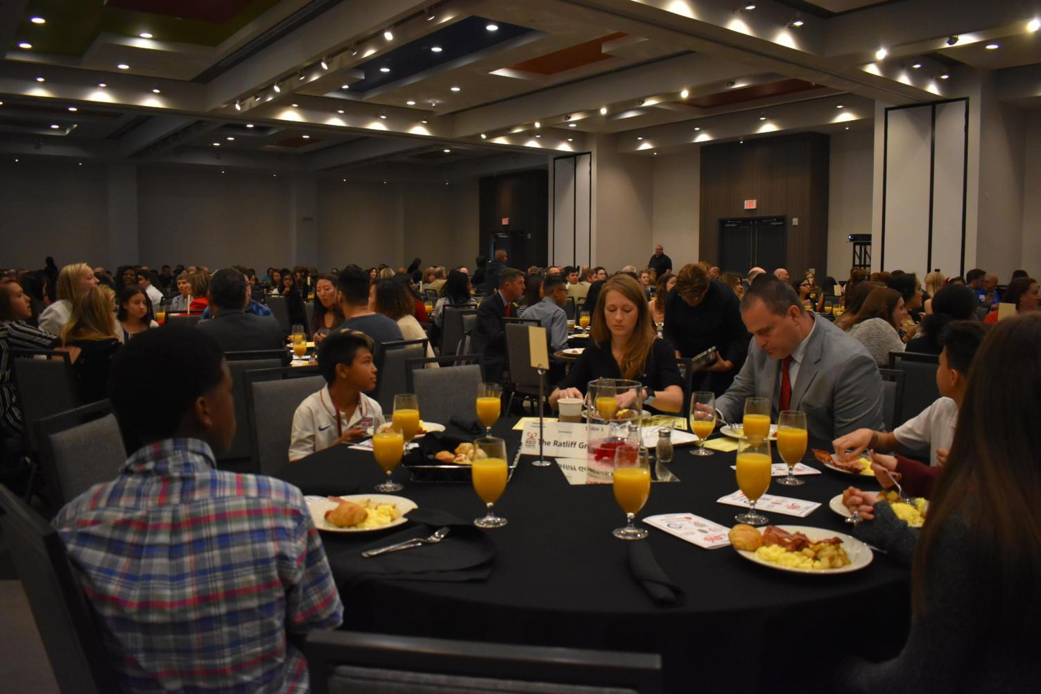 Coppell, Carrollton, Farmers Branch and Addison citizens have breakfast yesterday morning at the Four Points by Sheraton Hotel in Coppelll. The Coppell Chamber of Commerce hosted the 2017 Red Ribbon Breakfast in order to spread awareness against the use of drugs.