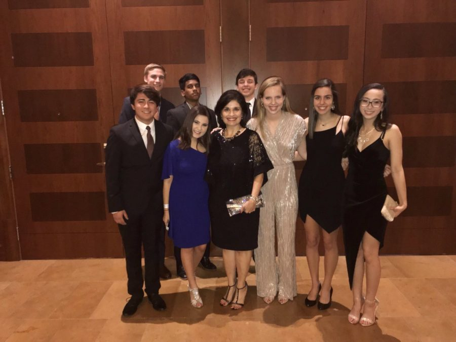 Coppell High School seniors Henry Noel, Ashwin Suresh, Cole Calabro, John Coffee, Ashley Miznazi, Rachel Behrnt, Haley Wafford and Marissa Green stand with KCBY-TV adviser Irma Kennedy at the Lone Star Emmy Awards at the JW Marriott Hill Country Resort in San Antonio on Saturday. KCBY had nine nominations in six categories, winning five, including the Best Newscast Award.