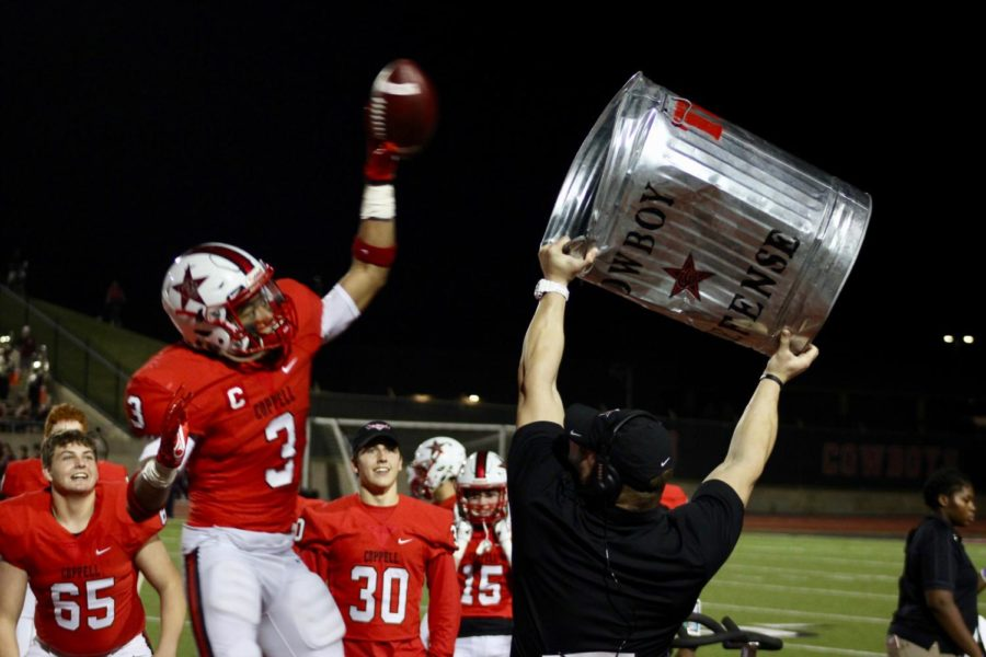 Coppell+high+school+junior+wide+receiver+Jonathan+McGill+celebrates+a+interception+during+the+game+against+Rowlett+Eagles+at+Buddy+Echols+field+on+Nov+17th.+The+Coppell+Cowboys+defeated+the+Rowlett+Eagles+37-6%2C+and+will+now+advance+to+the+second+round+of+playoffs.+