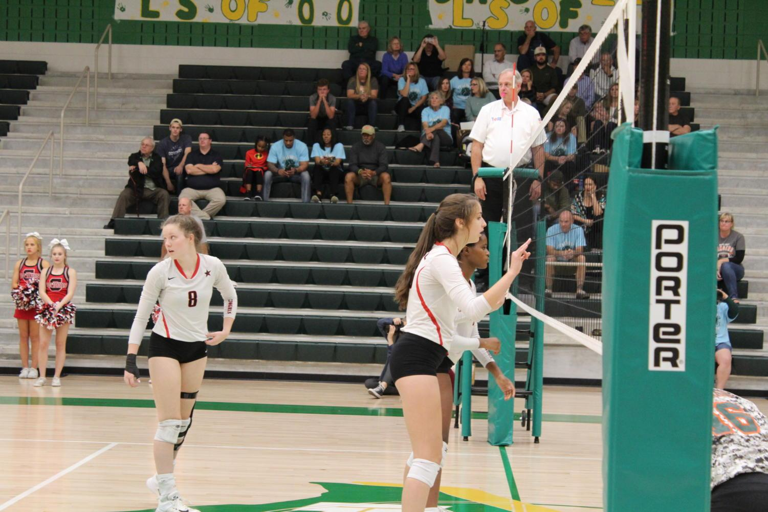 Coppell High School seniors Amanda Colon, Riley Ross and junior Amarachi Osuji play defense  against Lebanon Trail High School  Monday night at Frisco Lebanon Trail's gymnasium. The Cowgirls defeated the Lady Rangers in  three sets 25-8, 25-15, 25-20 to advance to the area round of the 6A state playoffs.